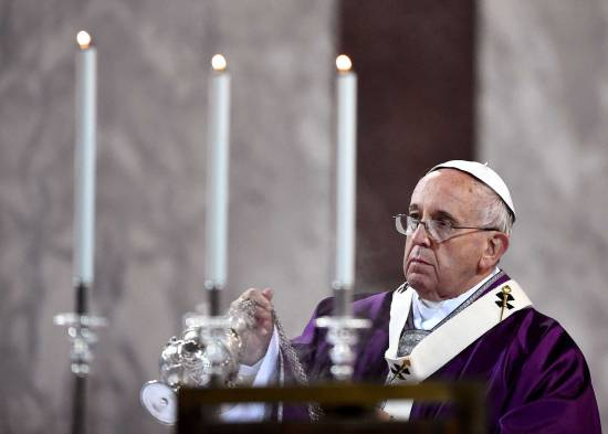 Pope Francis' Guide to Lent: What You Should Give Up This Year. In this photo, Pope Francis leads the Ash Wednesday mass opening Lent, the forty-day period of abstinence and deprivation for Christians, before Holy Week and Easter on February 18, 2015 at Santa Sabina church in Rome.  AFP PHOTO POOL/GABRIEL BOUYS/Getty Images